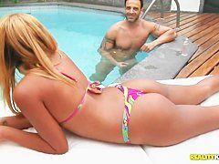 Pretty chick Evelyn learns her first cock lesson at the pool