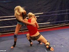 Two blondes Laura Crystal and Michelle Moist in ring