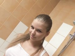 Beautiful Euro teen showering and showing pussy